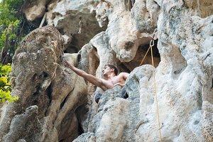 man rock climbing on white mountain