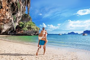 Happy couple in love on tropic beach