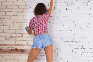 Woman painting wall home improvement