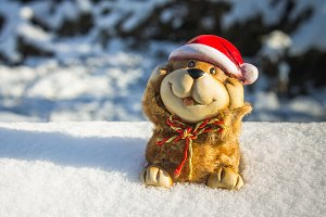 A toy of a dog is a symbol of the new year in the snow. Christmas toys.