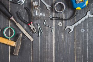 Joinery tools on a dark wooden table. Place for the text. A concept for Father's Day.