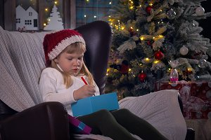 Child decorates gifts for new year and Christmas