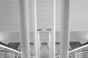White interior of airport with columns