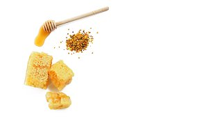 Honey with dipper, honeycomb and bee pollen on white background