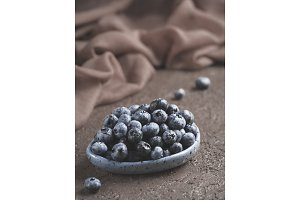 Blueberry on brown background copy space