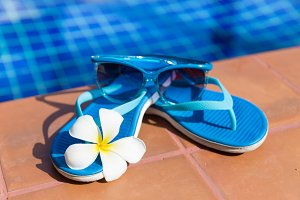 sunglasses slippers swimming pool