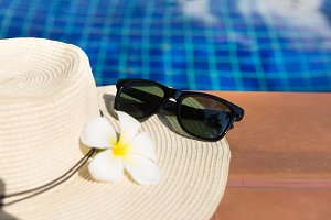 sunglasses straw hat swimming pool