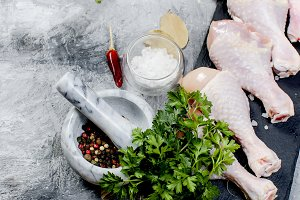 Raw chicken legs with spice