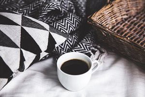 A cup of coffee. Breakfast in bed