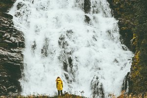 Woman enjoying big waterfall
