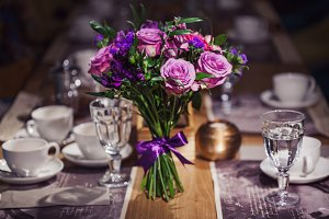 Flowers composition in restaurant,