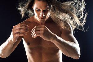 muscular man with long hair