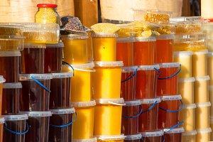 Many jars with honey