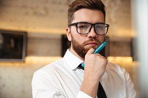 Close up portrait of a pensive bearded businessman
