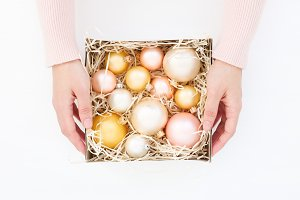 Women's hands & baubles in box