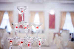Glass goblets. Pyramid of champagne.