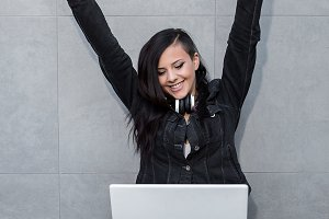 Woman celebrating at laptop