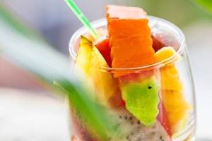 Glass of tropical exotic fruits salad