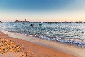 Vietnam Mui Ne village fishing boats and ships in sunset light