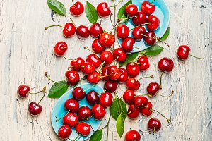 Tasty red cherries with leaves