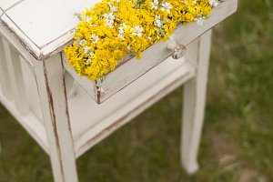 Vintage old table and wild flowers
