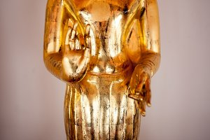 Gold figure of Buddha in temple