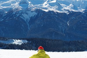 Snowboarder sitting on the snow