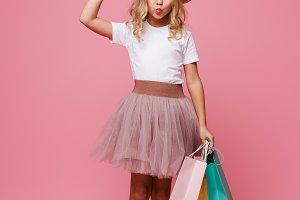 Full length portrait of a cute little girl in hat