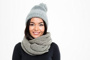 Smiling young asian lady wearing warm hat and scarf