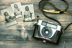 Vintage camera and old baby photos