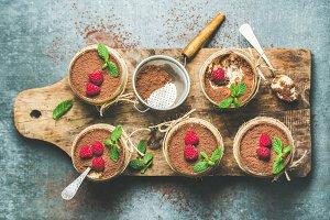 Homemade dessert Tiramisu in glasses on wooden board