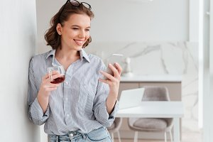 Portrait of a happy attractive woman using mobile phone