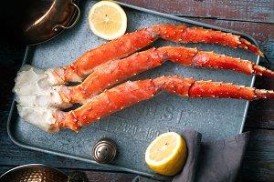 Fresh crab claws on metallic tray