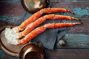 Fresh crab claws on wooden background