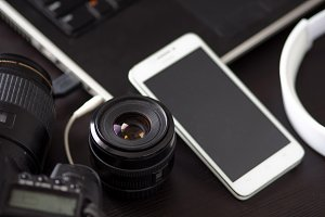 DSLR camera and a mobile phone with