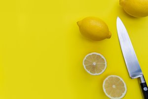 Lemons on yellow background