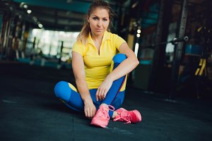 Girl in fitness club. Young female