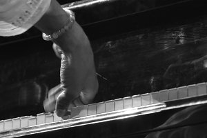 Fingers playing the piano