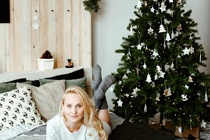 blonde and Christmas fir-tree