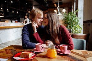 loving couple sitting in a cafe