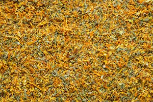 Background of dry marigold petals.
