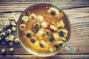 Healthy chamomile tea cup. Top view.