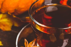 Cup of tea with autumn decorations