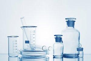 Various empty glass medicine bottles
