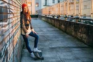 Skater woman enjoying the sunset