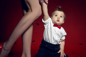 sexy girl in red short dress with a boy child