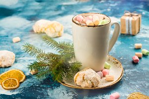 Hot chocolate with marshmallows and cookies on Christmas background