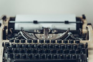 Old vintage typewriter with blank pa