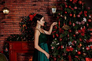 brunette decorates Christmas tree