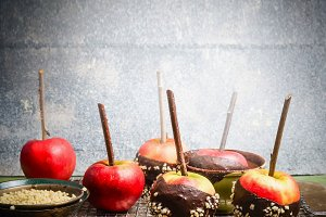Apples on sticks with chocolate